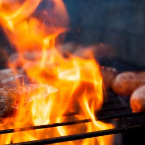 What should you do if you have a fire outbreak on your barbecue?