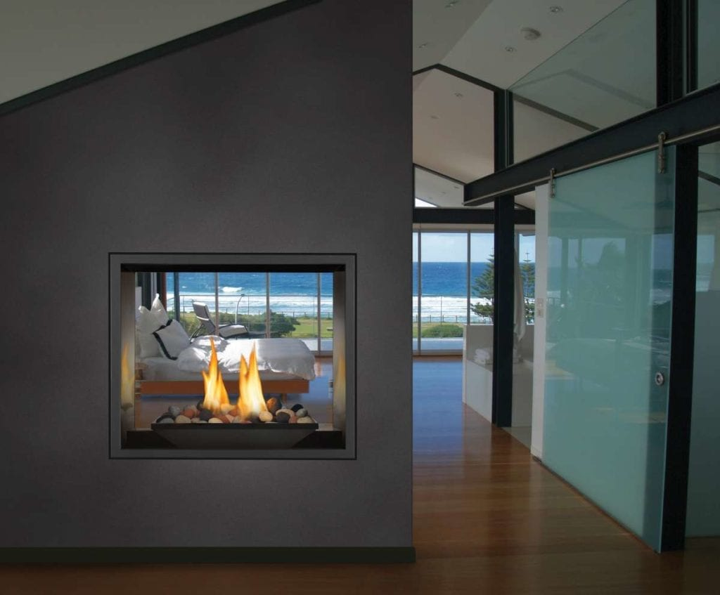 Why does the glass on my fireplace fog up when I turn it on?