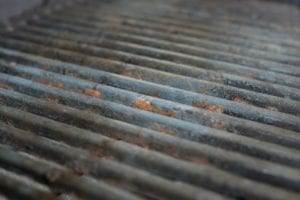 A rusty grate is one of the signs that it may be time to buy a new grill.
