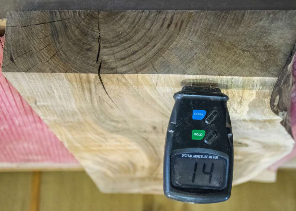 You can measure wood humidity with a moisture meter