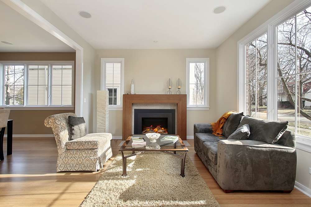 Can I use an electric fireplace as an insert for my old wood-burning fireplace?