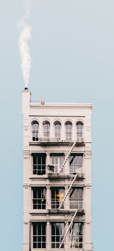 Image from Jeffrey Czum, pexel -- Nice apartment building with chimney, should I hire to clean my chimney?