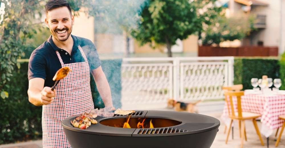 Man with apron cooking on a BBQ, Grill. How to host the best social distancing summer BBQ ever!